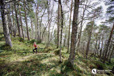 Woman trail running in Norway